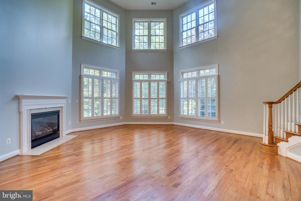 Family Room with rear staircase - 862 CENTRILLION DR, MCLEAN