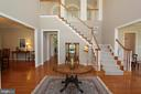 Behold the two-story foyer with gleaming hardwoods - 4303 SARATOGA SPRINGS CT, MIDDLETOWN