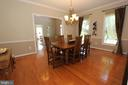 Formal dining room with gleaming hardwood floors - 4303 SARATOGA SPRINGS CT, MIDDLETOWN