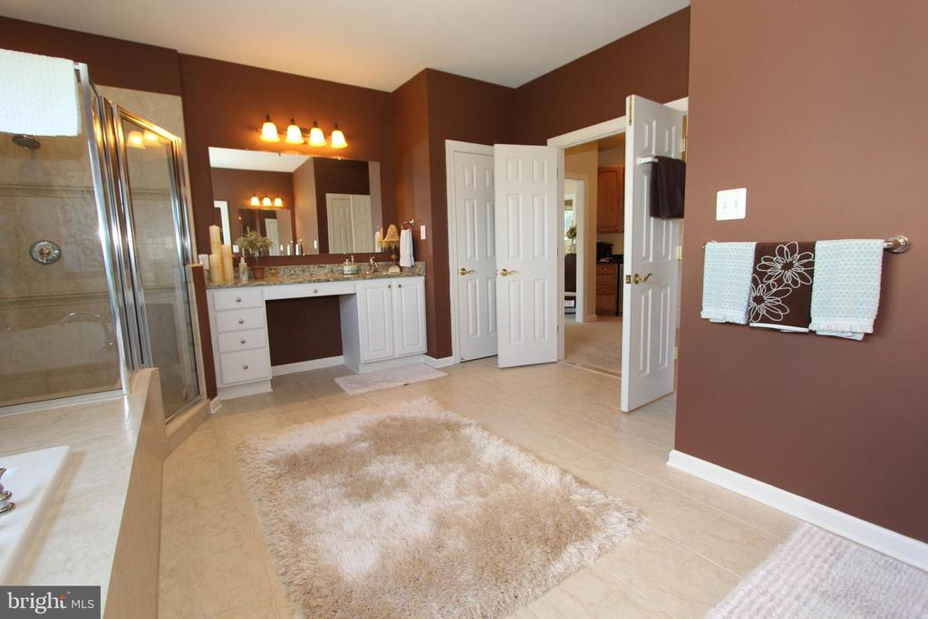 Master bath features ceramic tile floors - 4303 SARATOGA SPRINGS CT, MIDDLETOWN