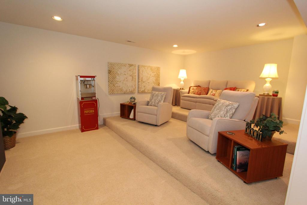 Lower level tiered theater room - 4303 SARATOGA SPRINGS CT, MIDDLETOWN