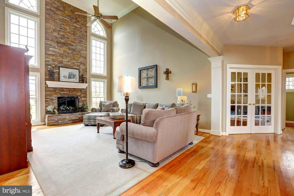 Great room, hallway and library entry - 22910 PEACH TREE RD, CLARKSBURG