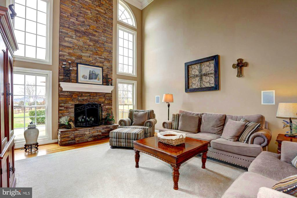 Great Rm floor to ceiling stone hearth and windows - 22910 PEACH TREE RD, CLARKSBURG