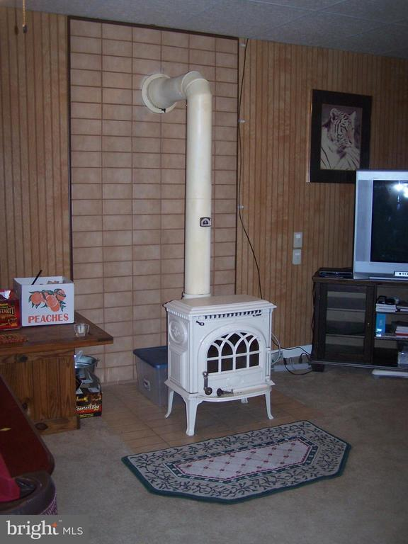 Wood stove which can help keep home toasty !! - 3548 WINDING RD, PARTLOW
