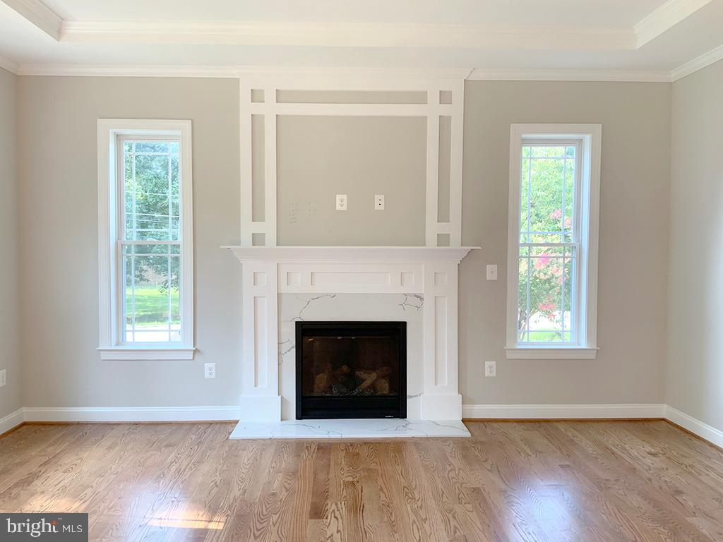 Fireplace with Wood Mantle and Quartz Surround - 6617 GREENLEAF ST, SPRINGFIELD