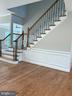 Stained Oak Staircase with Iron Pickets - 6617 GREENLEAF ST, SPRINGFIELD