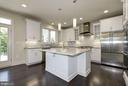 Gleaming two-tone quartz countertops! - 10106 DICKENS AVE, BETHESDA