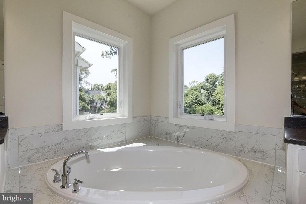 Enjoy a relaxing bath in your private soaking tub. - 10106 DICKENS AVE, BETHESDA