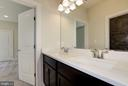 Jack&Jill bathroom w/ quartz-topped double vanity. - 10106 DICKENS AVE, BETHESDA