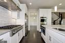 Spacious kitchen feat. maple shaker-style cabinets - 10106 DICKENS AVE, BETHESDA