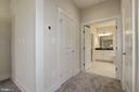 His & Her walk-in closets leading to Master Bath. - 10106 DICKENS AVE, BETHESDA
