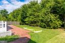 Stamped walkway from the driveway to rear patio - 18494 QUANTICO GATEWAY DR, TRIANGLE