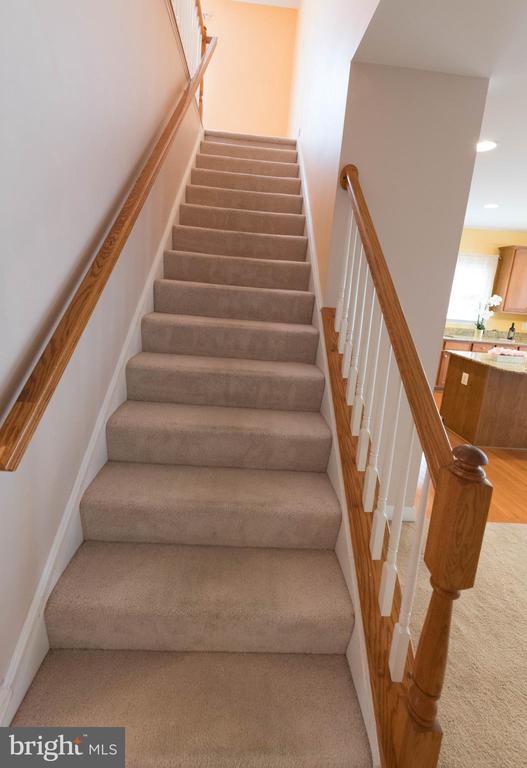 Stairs leading to the third floor - 18494 QUANTICO GATEWAY DR, TRIANGLE