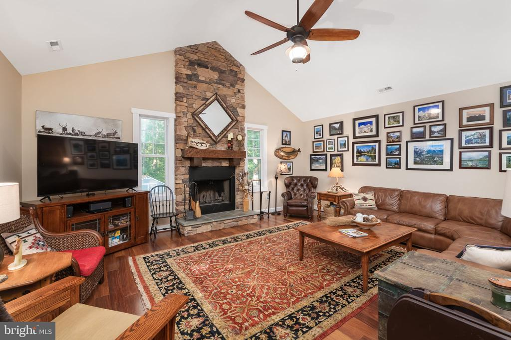 Family Room w/ Wood Burning Fireplace - 1205 SPOTSWOOD DR, LOCUST GROVE