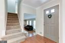 Foyer Leading to Lower Level Family Room - 12335 COLERAINE CT, RESTON