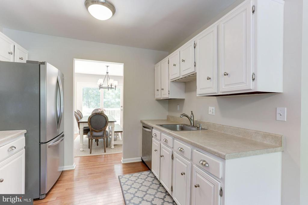 Kitchen Features Abundance of Cabinets! - 12335 COLERAINE CT, RESTON