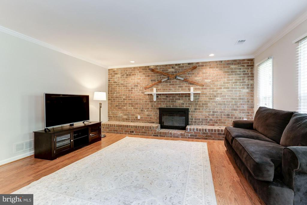 Family Room / Rec Room with  Lovely Brick Wall - 12335 COLERAINE CT, RESTON