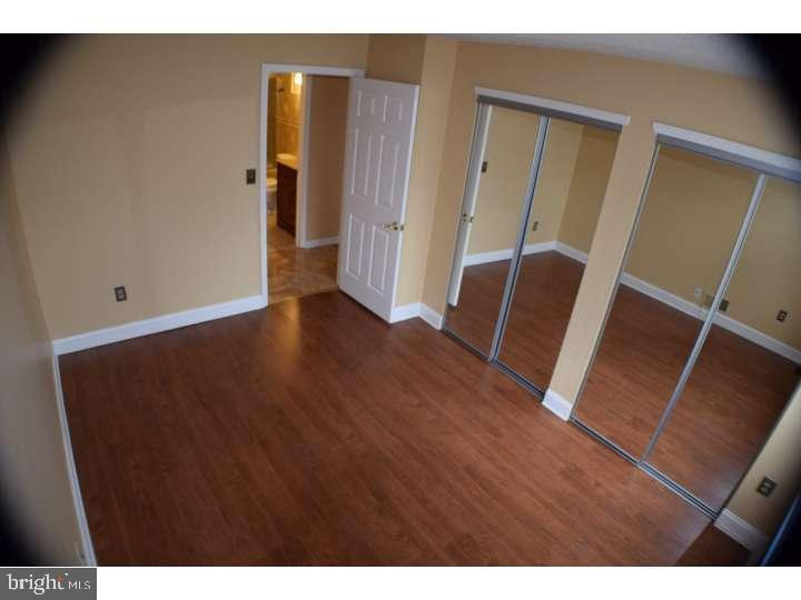 Second bedroom with Laminate flooring
