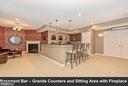 Basement bar - granite counters and fireplace. - 6902 SOUTHRIDGE PL, MIDDLETOWN
