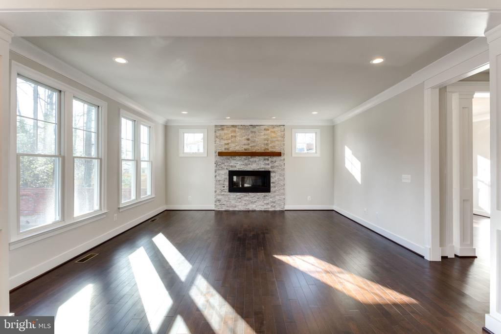FAMILY-ROOM WITH GAS FIREPLACE. - 313 CABIN RD SE, VIENNA