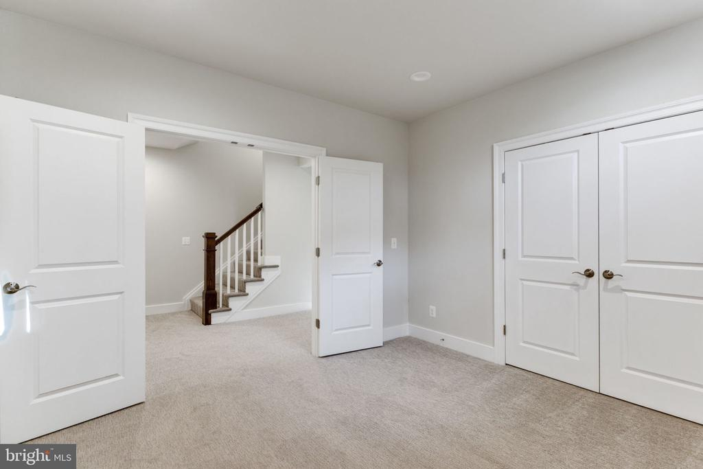 LOWER LEVEL EXERCISE ROOM. - 313 CABIN RD SE, VIENNA