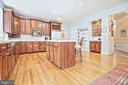 Kitchen Opens to Great Room - 10121 COMMUNITY LN, FAIRFAX STATION