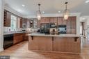The kitchen has an enormous center island - 5621 GLENWOOD DR, ALEXANDRIA