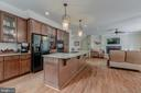 The kitchen flows into the family room - 5621 GLENWOOD DR, ALEXANDRIA