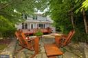 View to deck and paver patio from destination area - 5621 GLENWOOD DR, ALEXANDRIA