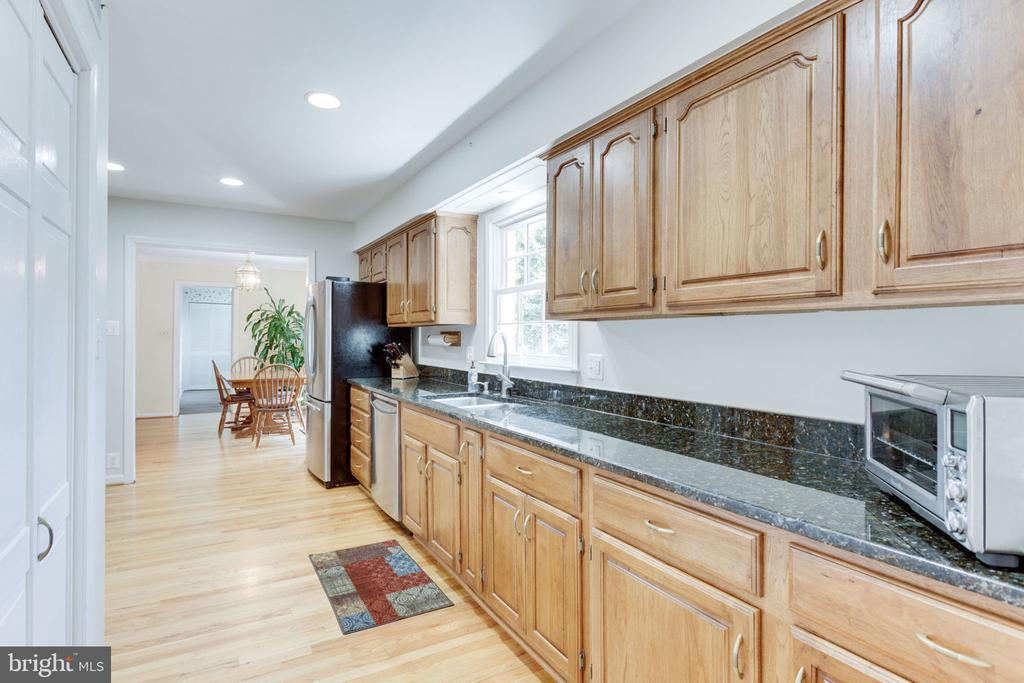 View toward breakfast area. Large pantry on left. - 7710 FALSTAFF CT, MCLEAN