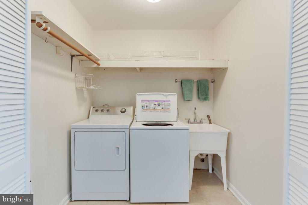Main level laundry off of hobby room - 7710 FALSTAFF CT, MCLEAN