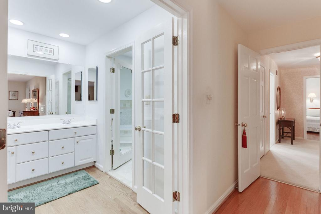 Entry to master updated dressing area and bath - 7710 FALSTAFF CT, MCLEAN