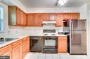 Kitchen with new fridge - 108 GALAXIE DR, FREDERICKSBURG