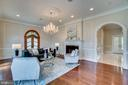 Living room with wainscoting and chandelier - 10120 COUNSELMAN RD, POTOMAC