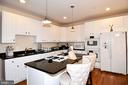 Gas cooking with stovetop & double ovens. - 1850 BRENTHILL WAY, VIENNA