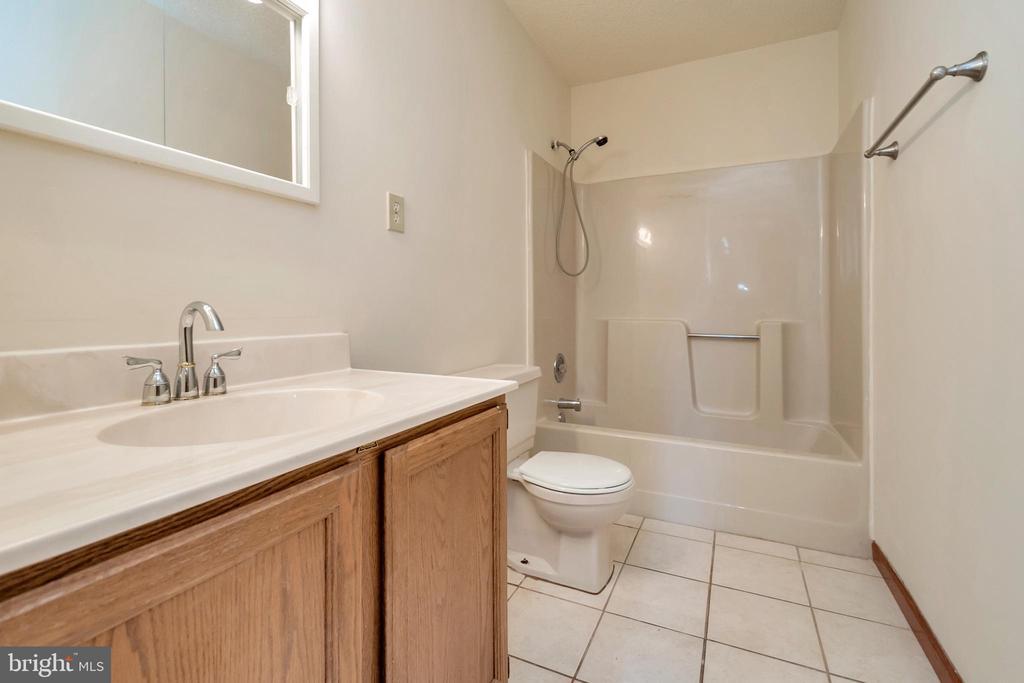 full bath in basement - 10620 HOLLEYBROOKE DR, SPOTSYLVANIA