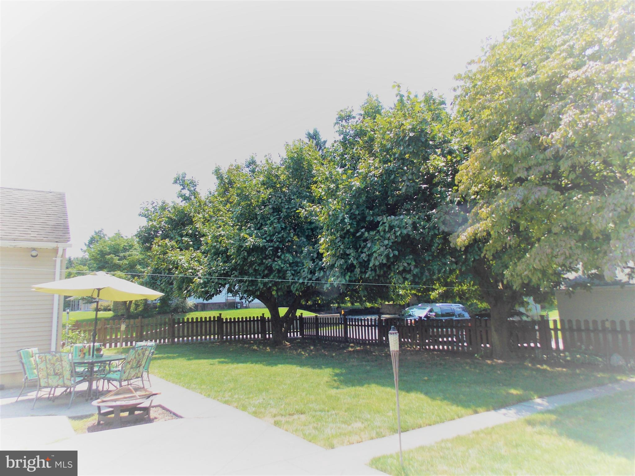 Fenced back yard with large patio for gatherings