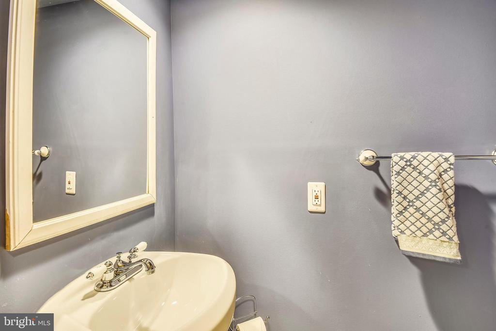 Powder room on lower level! - 9919 MACARTHUR BLVD, BETHESDA