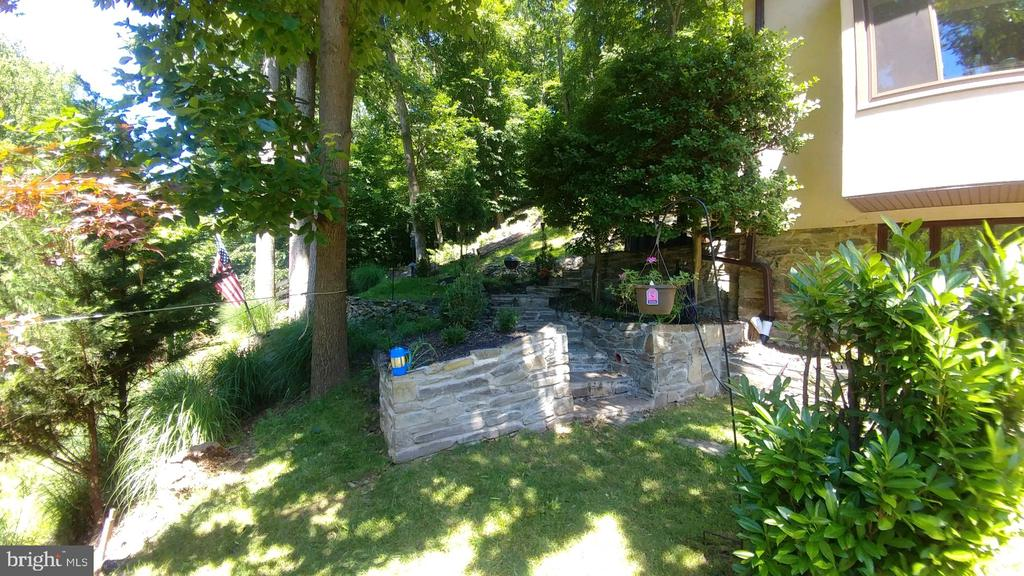 Many hardscape features including stone walls! - 9919 MACARTHUR BLVD, BETHESDA