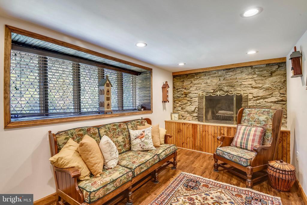 Lower level with wood burning stone fireplace! - 9919 MACARTHUR BLVD, BETHESDA