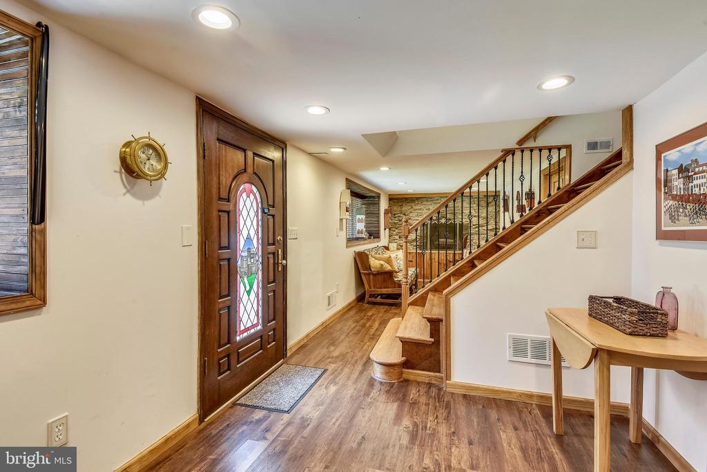 Foyer and lower level family room! - 9919 MACARTHUR BLVD, BETHESDA