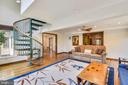 Family room with spiral stairs to upper level! - 9919 MACARTHUR BLVD, BETHESDA