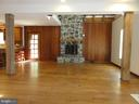 Family room with stone fireplace & hardwood floors - 38699 OLD WHEATLAND RD, WATERFORD