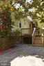 Front deck leads to stone patio - 8907 CHRISTINE PL, MANASSAS