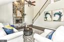 Family rm features stone fireplace & vault ceiling - 47426 RIVERBANK FOREST PL, STERLING