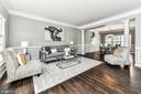 Bright formal living room with new espresso floors - 47426 RIVERBANK FOREST PL, STERLING