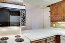 Kitchen - Plenty of Solid Wood Cabinets - 3800 FAIRFAX DR #314, ARLINGTON