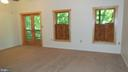 Walk out to  spacious covered deck.  10