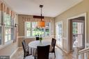 Breakfast room with views of patio and lush yard - 9114 MURDOCK RD, FAIRFAX