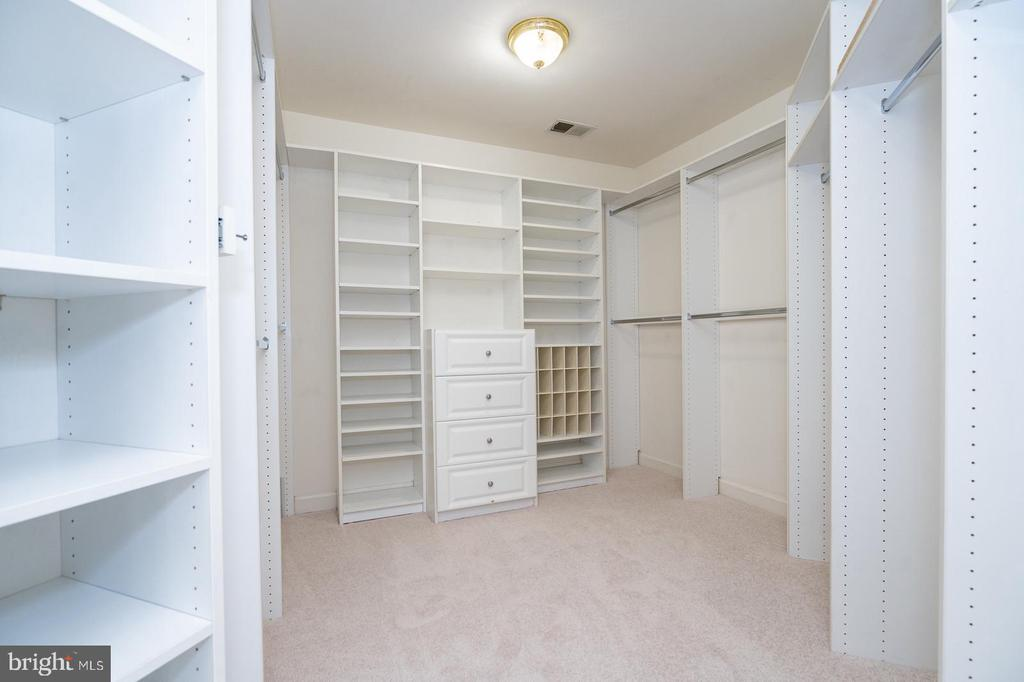 Master closet decked out by Closet By Design - 26112 TALAMORE DR, CHANTILLY